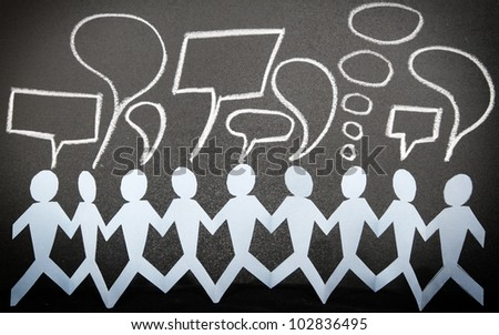 Paper doll people holding hands and speech bubbles