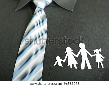 Paper family in a businessman's pocket - stock photo