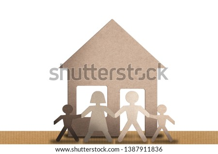 paper family with people with various skin colors. Concept of interracial adoption or modern family.