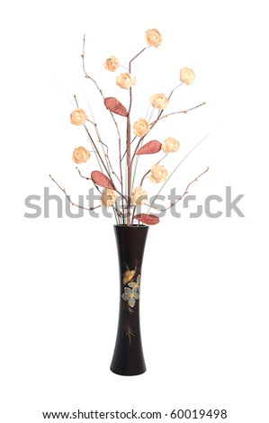 Paper flowers arrangement in a wooden vase.