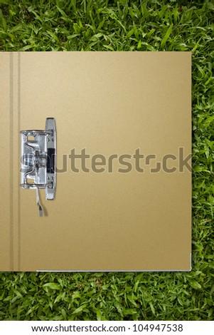 paper folder on grass