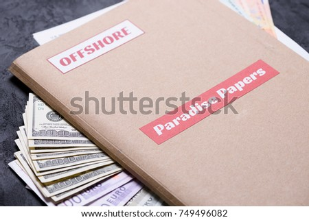 Paper folder with Paradise papers label on it with euro and dollar currency, offshore tax heavens documents leak concept #749496082