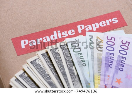 Paper folder with Paradise papers label on it with euro and dollar currency, offshore tax heavens documents leak concept