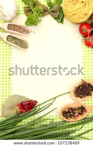 paper for recipes,vegetables and spices on green background - stock photo