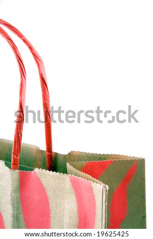 Paper gift bag with handles isolated on white - stock photo