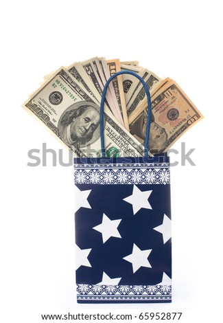 Paper gift bag with heap of dollars in it. Isolated over white background