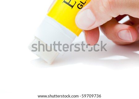 Paper glue stick with hand isolated on white