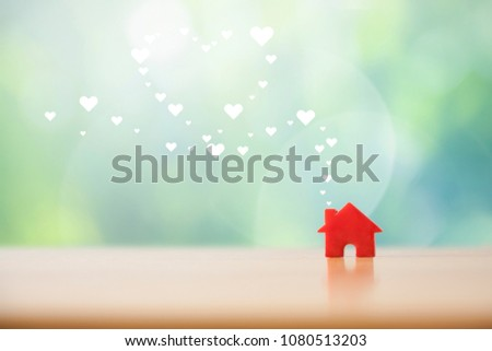 Paper heart floating out of the red house.Sweet home concept. #1080513203