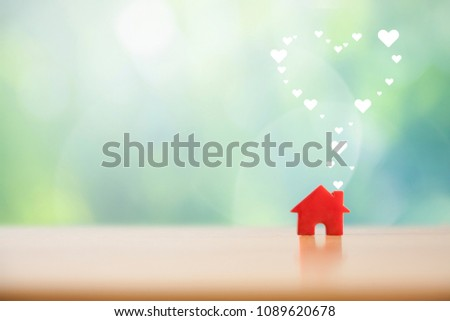 Paper heart floating out of the red house.Sweet home concept. #1089620678