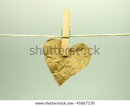 Paper heart hanging on rope
