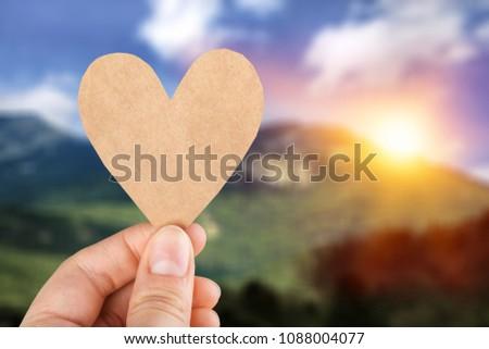 Paper heart in hand #1088004077