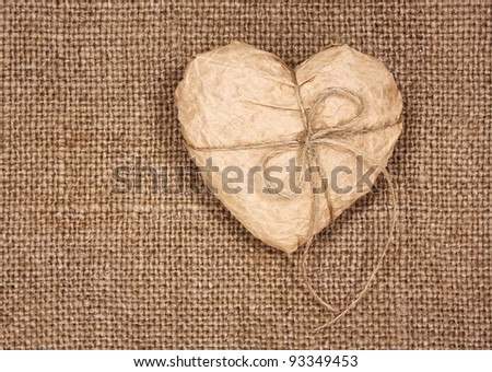 paper heart on a burlap, as a  background