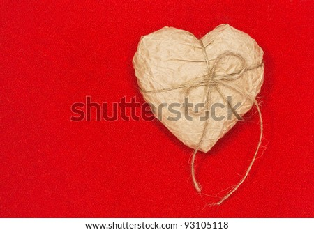 Paper heart on red background. Concept - stock photo