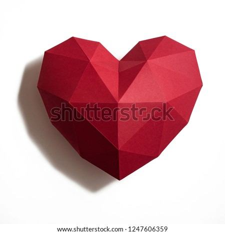 Photo of  Paper hearth with shadow. Red polygonal paper heart for Valentine's day or any other Love invitation cards.