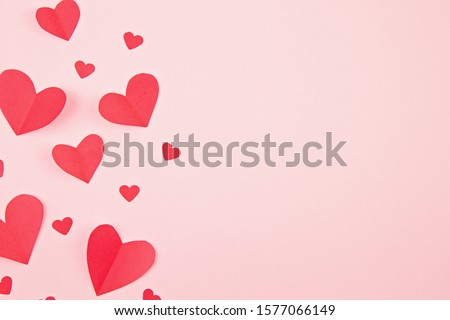 Paper hearts over the pink pastel background. Abstract background with paper cut shapes. Sainte Valentine, mother's day, birthday greeting cards, invitation, celebration concept Stock photo ©