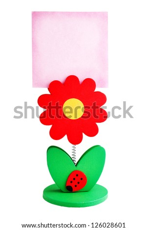 paper holder in shape of a flower with a paper sheet isolated on white