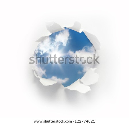 paper hole with blue sky and sun