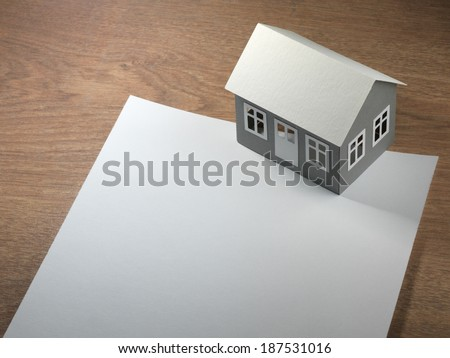 paper house and sheet of paper on the table #187531016