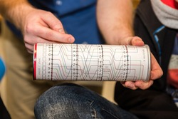 Paper imitation of a cylinder from an encryption, coding, secret enigma machine. Used for teaching or playing for children, students or logical training or cryptography studies at a university.