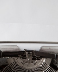 paper in old typewriter on wood table
