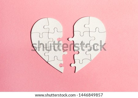 paper jigsaw puzzle heart split in two pieces isolated on pink background, top view, flat lay, divorce, depression and breakup concept, crying, medical cardiovascular health care problems #1446849857