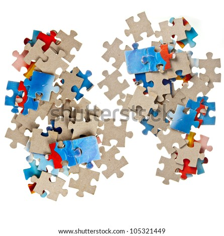 Paper jigsaw puzzle pieces isolated on white background