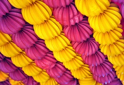 Paper lanterns (farolillos) yellow and purple at the April Fair in Seville, Andalusia, Spain