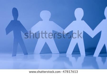 Paper little men holding hands