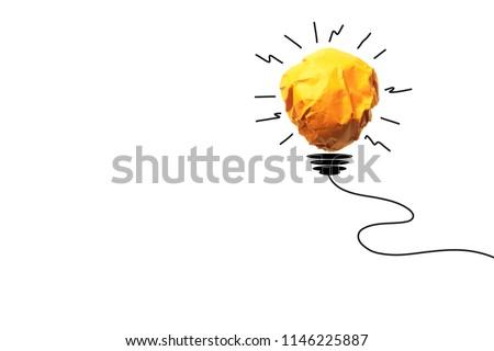Paper make to light bulb for idea power energy concept on white background.