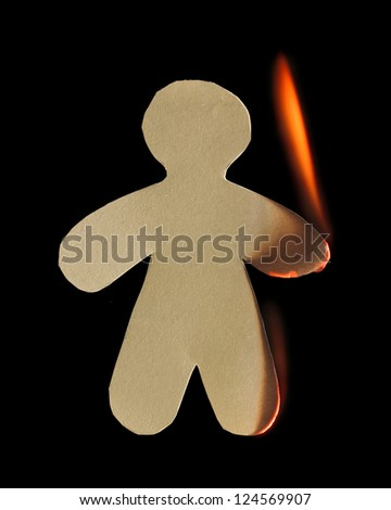 Paper man with arm and leg burn in flame on black background