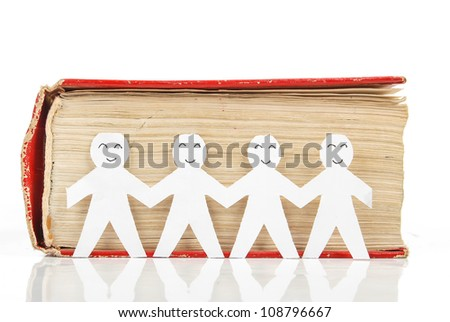 Paper man with book - stock photo