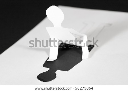 Paper man with the upper part of the body cut out of paper (getting ready to rise)