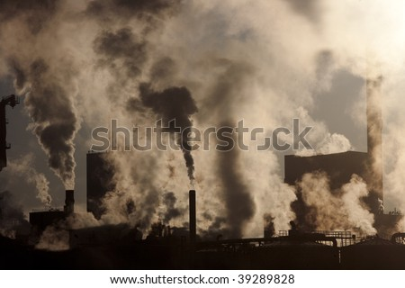 stock-photo-paper-mill-covered-by-heavy-smoke-screen-by-hazy-sunrise-39289828.jpg