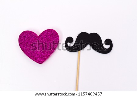 paper mustache on a stick and a pink heart on white background #1157409457