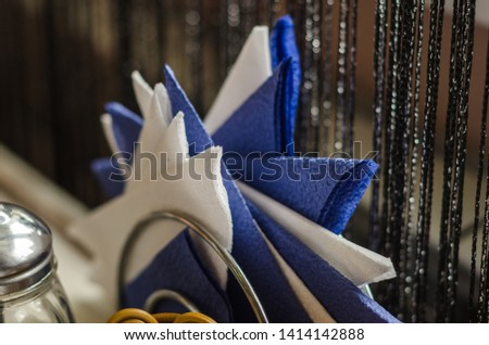 paper napkins in a napkin holder on the table