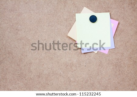 Paper note on wood texture background