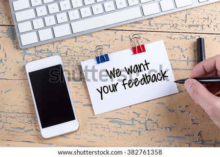 Paper note with text We want your feedback #382761358