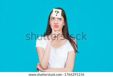 Paper notes with question marks. Confused female thinking with question mark on sticky note on forehead. Thinking woman with question mark. Doubtful girl asking questions to himself.