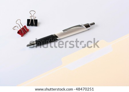 Paper office folder for documents, the pen and two clips for a paper.