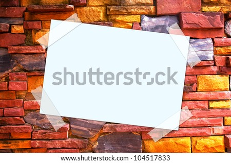paper on brick wall