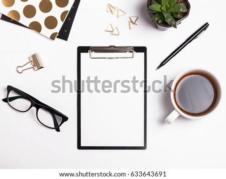 Paper on clipboard mock-up. Modern woman workplace.