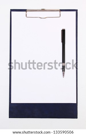 paper on Clipboard with pen