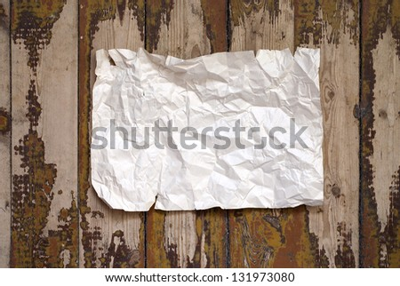 paper on the grunge plank floor background