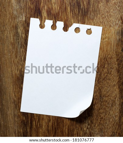 paper page notebook on the wood backgrounds.