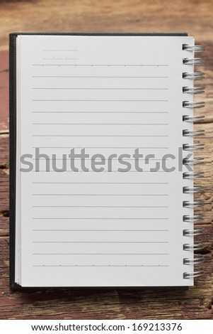 Paper page notebook. textured isolated on the wood backgrounds