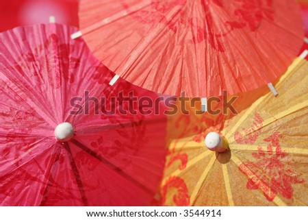 Paper parasols in pink, orange and yellow