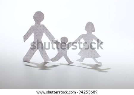 Paper people chain: men, woman and babies. Family concept. - stock photo