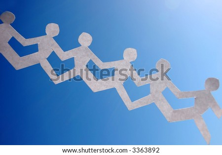 paper people  chain representing teamwork over blue sky - stock photo