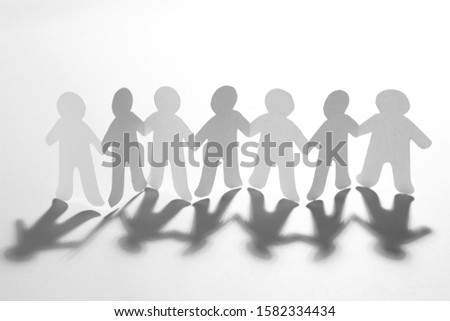 Paper people holding hands on white background. Unity concept #1582334434