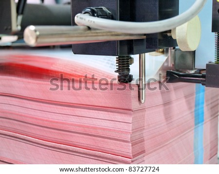 paper pile in a finishing, folder station in an offset printer